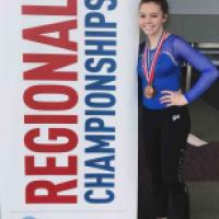 JC gymnast beaming after great year graphic